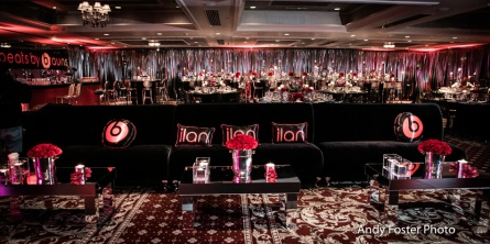 Black velvet couches with just a pop of red!
